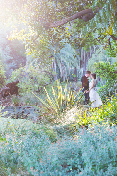 Magical light hits the foliage with couple loving each other