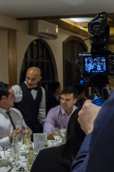Videographer filming groom