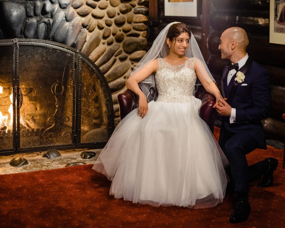 Chateau Wyuna Receptions - Bride and Groom in front of fireplace