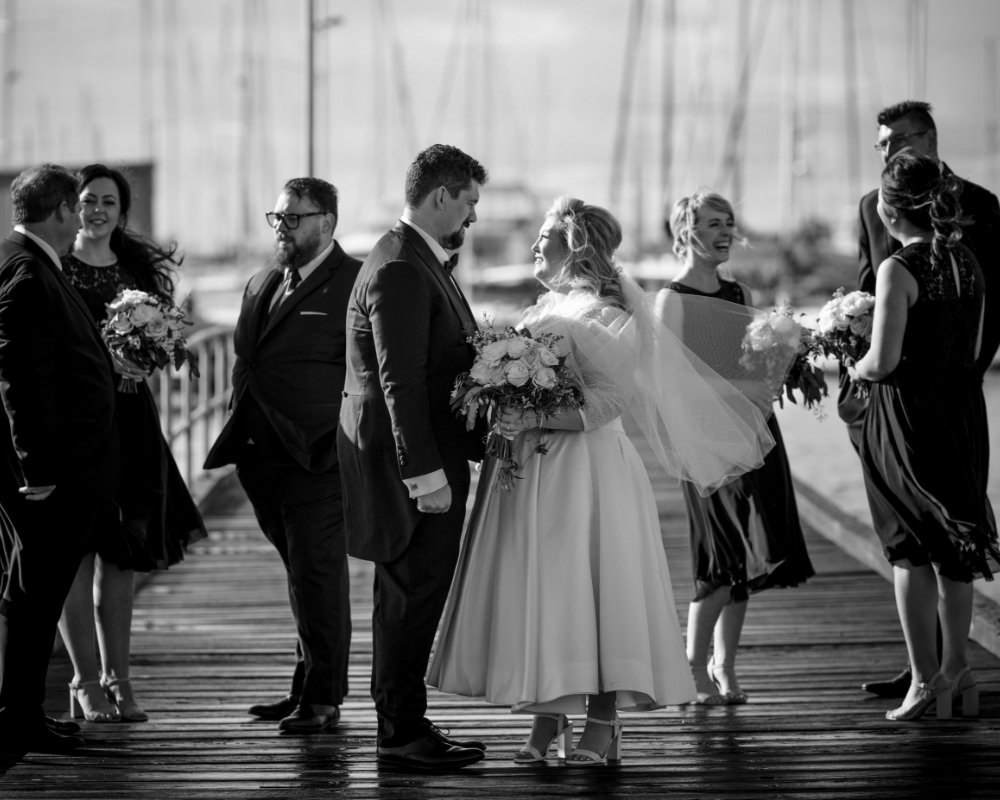 Sandy By The Bay - Bridal party on the pier