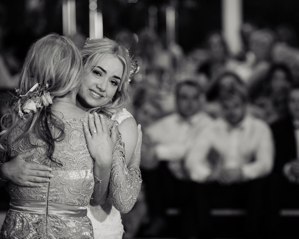 Bride and Mother of the Bride embracing