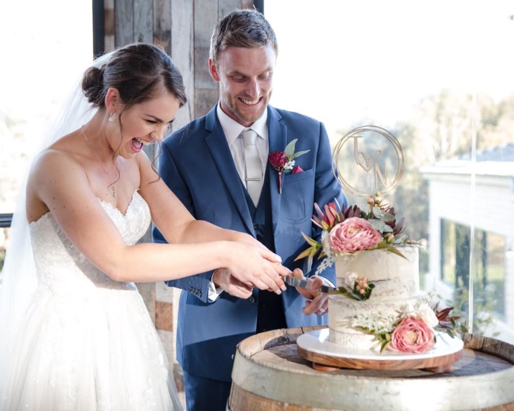 Flowerdale Estate - Bride and Groom cutting cake