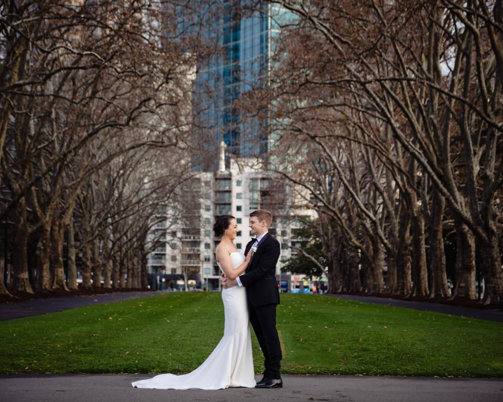 Carlton Gardens - Bride and Groom with Cityscape