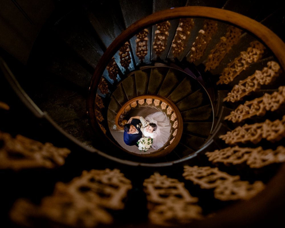 Overnewton Castle - Bride and Groom below spiral staircase