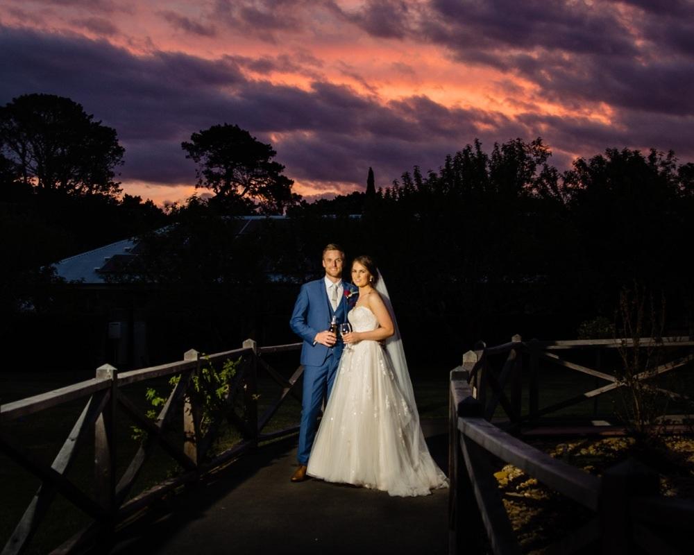 Flowerdale Estate - Bride and Groom on bridge at sunsetFlowerdale Estate - Bride and Groom on bridge at sunset