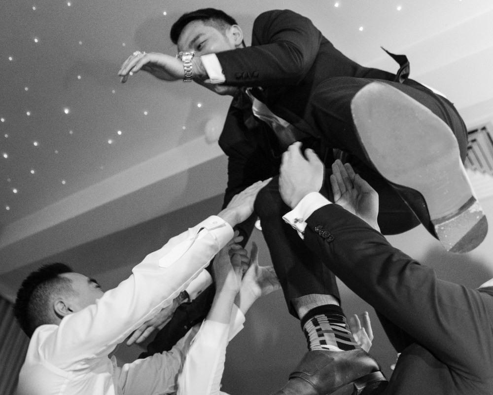 Brighton Receptions - Groom thrown in air
