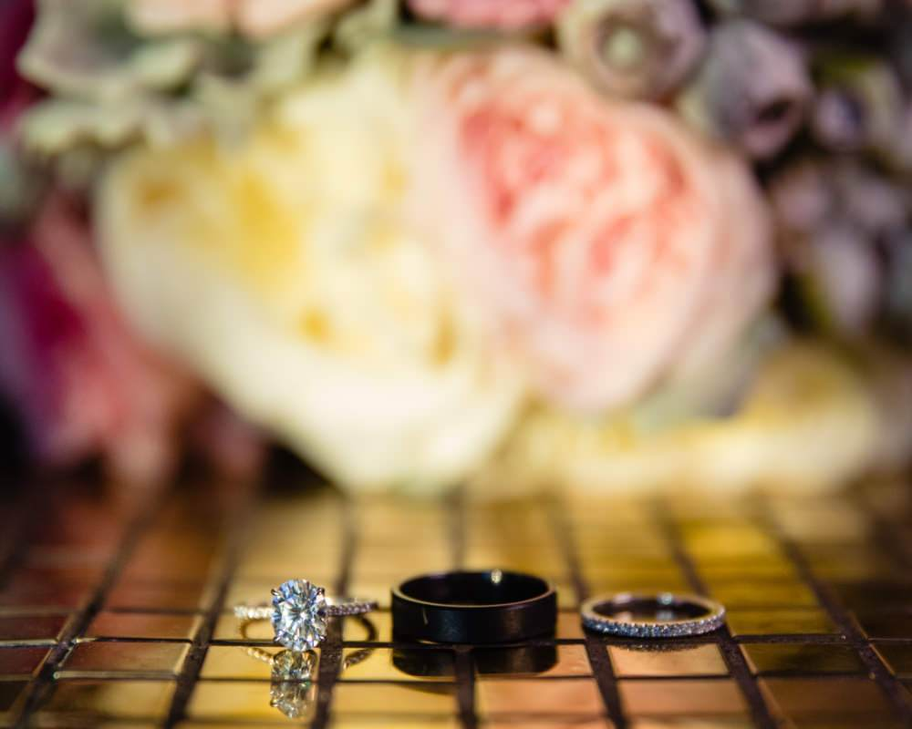 Wedding rings with bridal bouquet