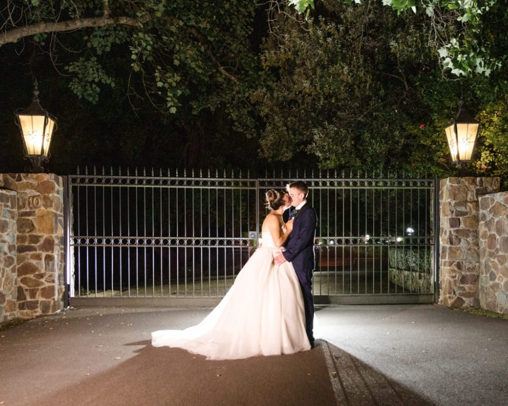 Marybrooke Manor - Bride and Groom in front of gate