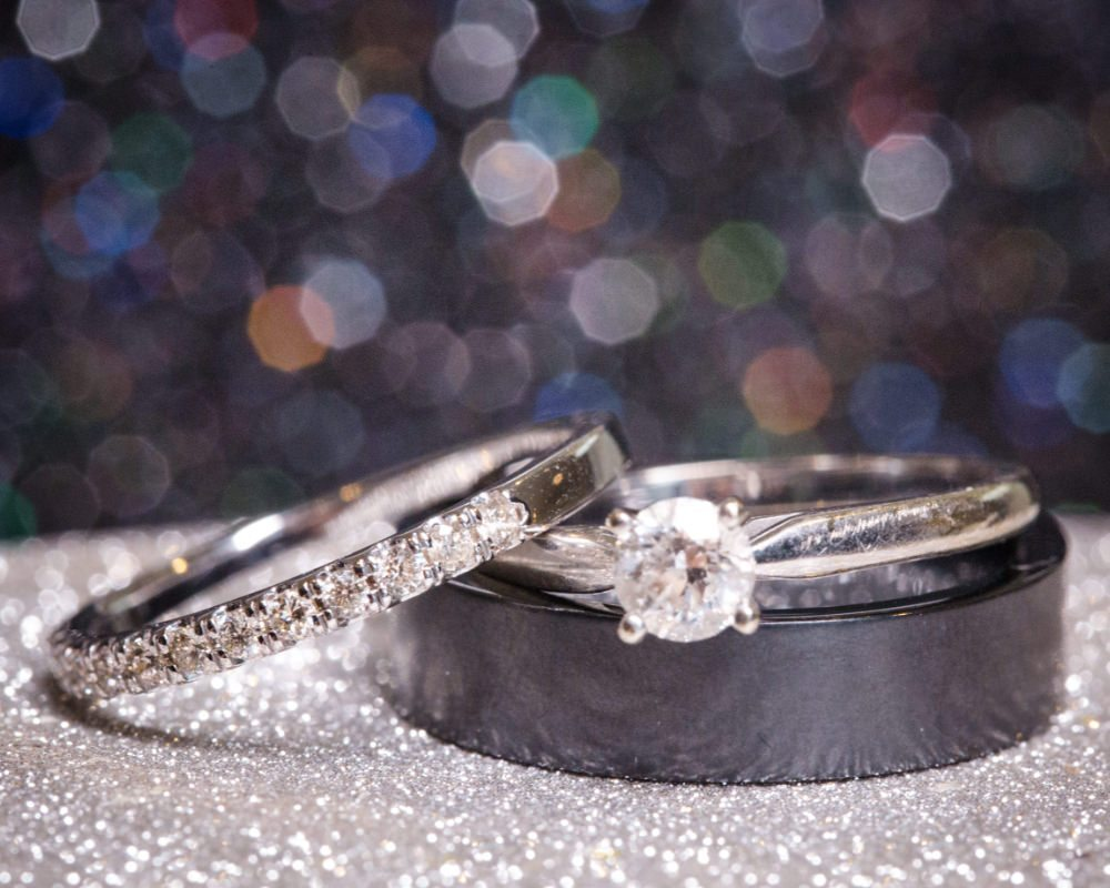 Wedding rings on glitter
