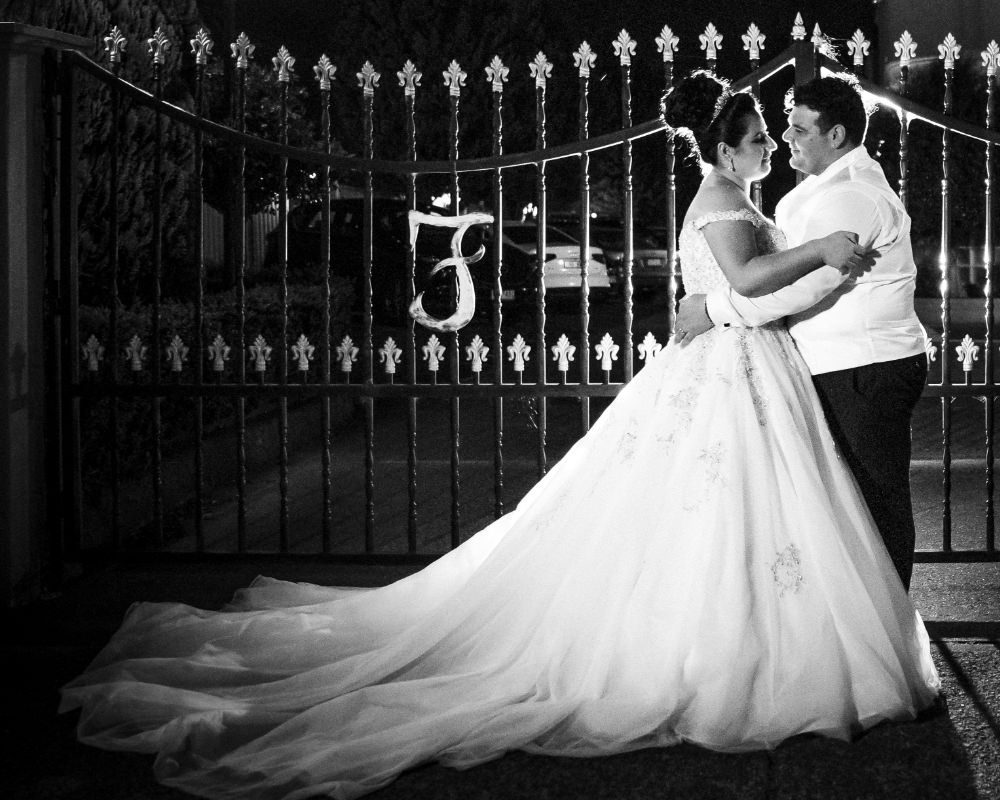 Ferraro Receptions - Bride and Groom in front of gate