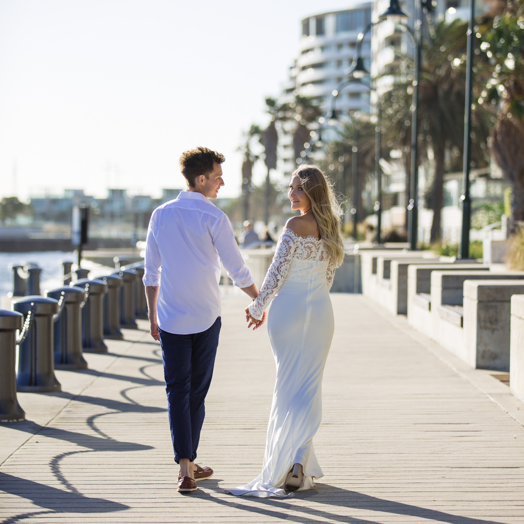Bride and Groom walking along Port Melbourne Pier