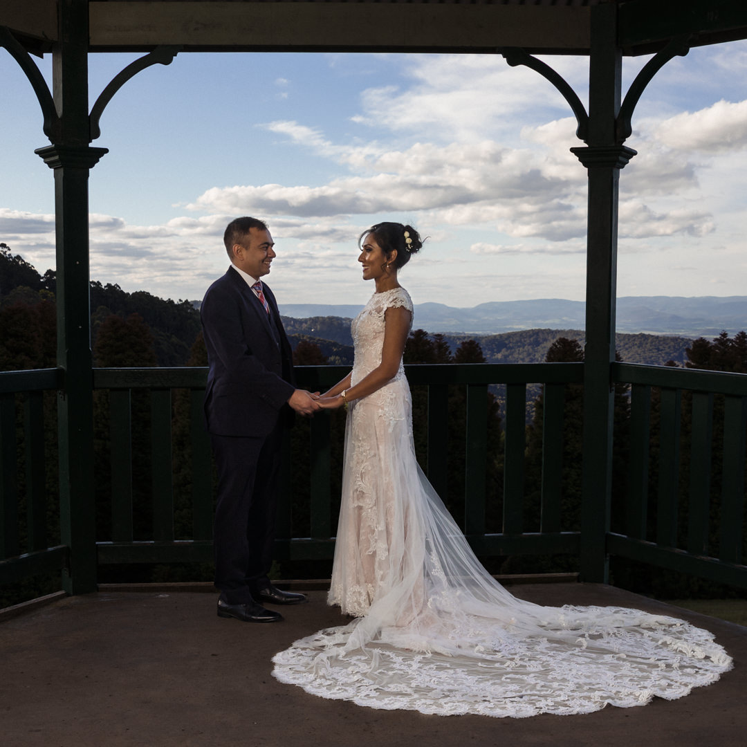 Couple looking at each other with the Dandenongs in the background
