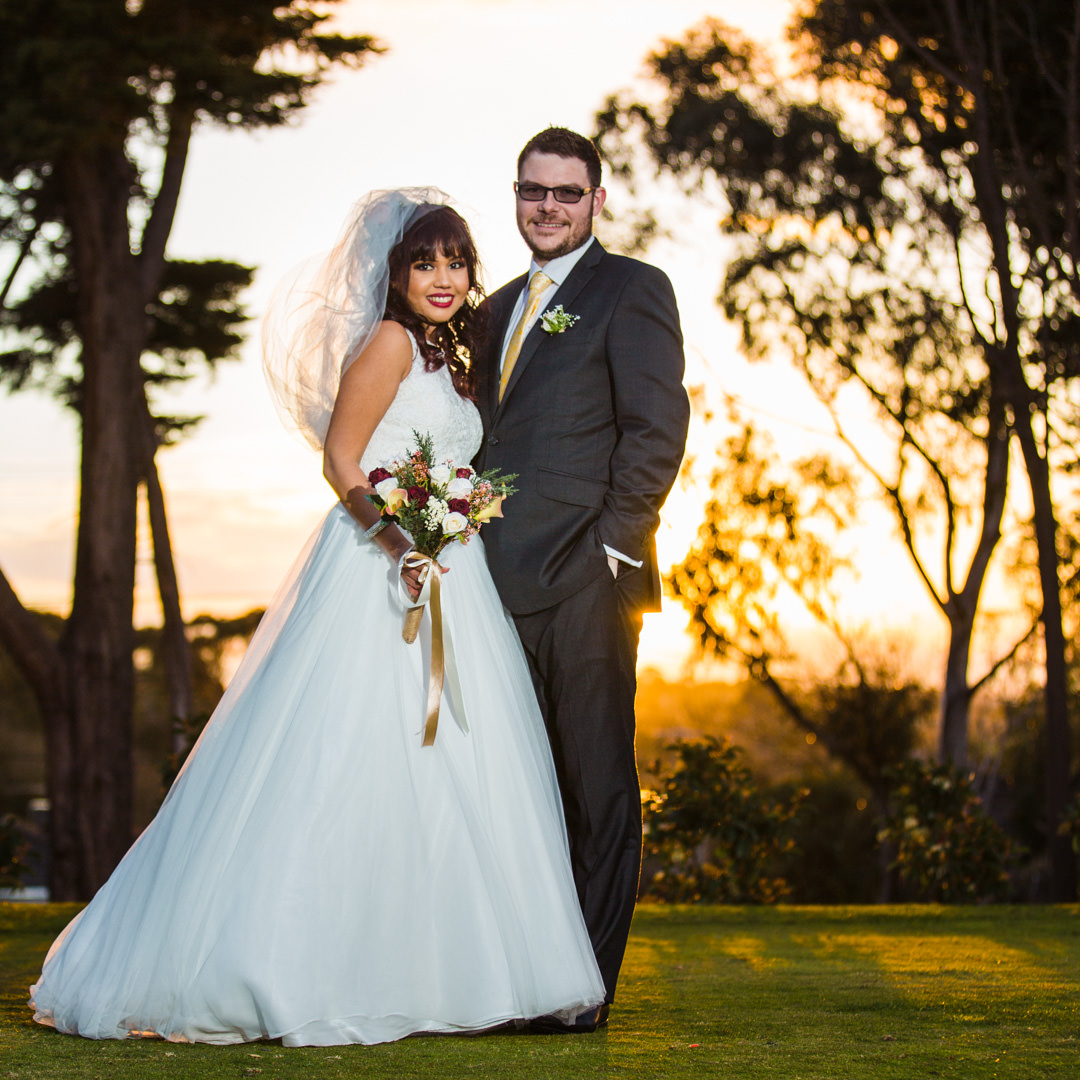 Bride and Groom in front of golden sunset
