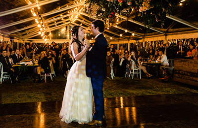 Bride and Groom's first dance in an outdoor marquee
