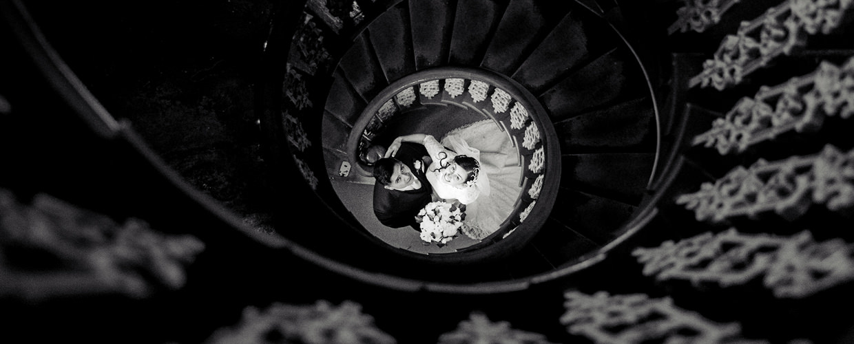 Bride and Groom at the bottom of spiral staircase
