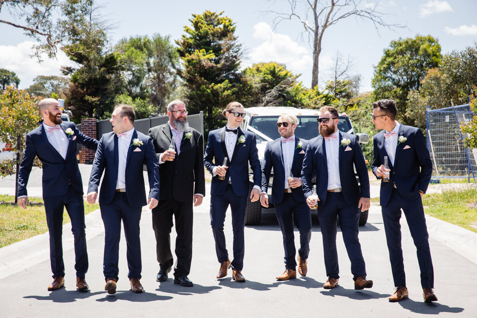 Groom and Groomsmen walking down the road