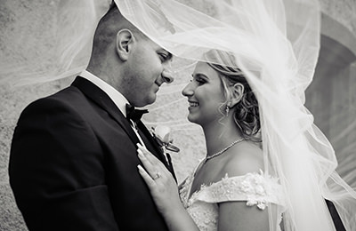 Bride and Groom looking at each other under veil