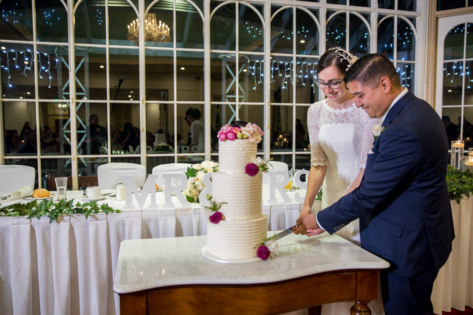 Jessica and Bodie's cutting the cake