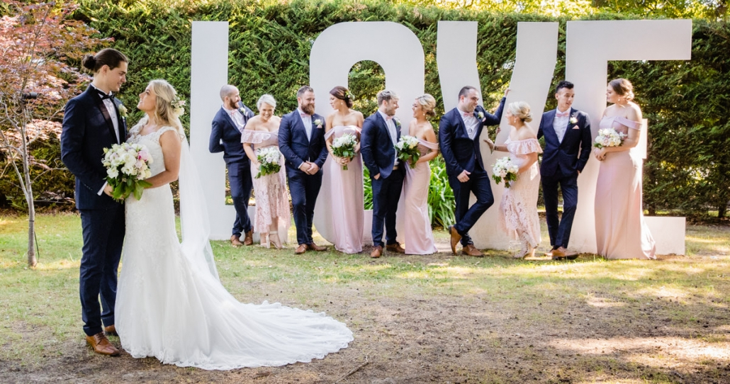 Bridal party in front of LOVE letters